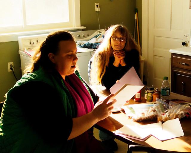 Sarah Reading Her Cards