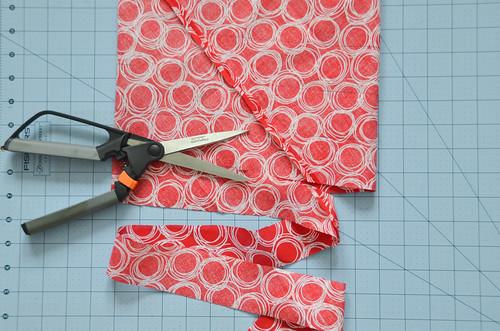 Ensure the line forms a spiral around the fabric tube, and start cutting along the line.