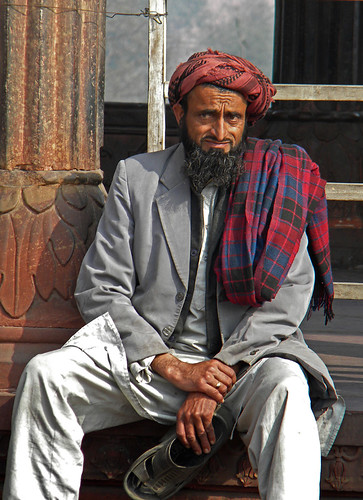 Man sitting on the steps of the Jama Masjid Mosque in Delhi India