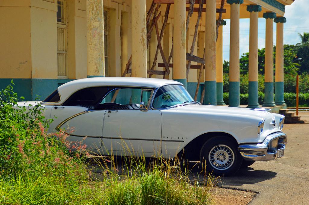White car outside Fidel Castro's old HQ