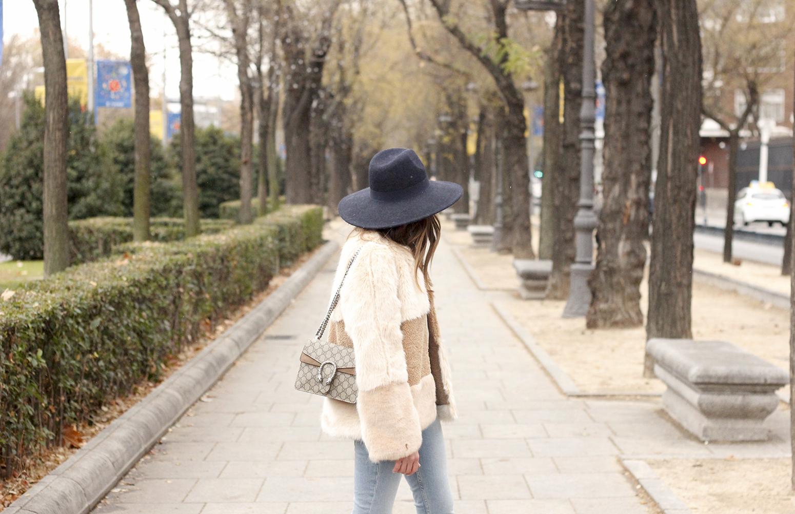 Beige faux fur coat zara blue hat nude heels jeans style fashion outfit winter 11