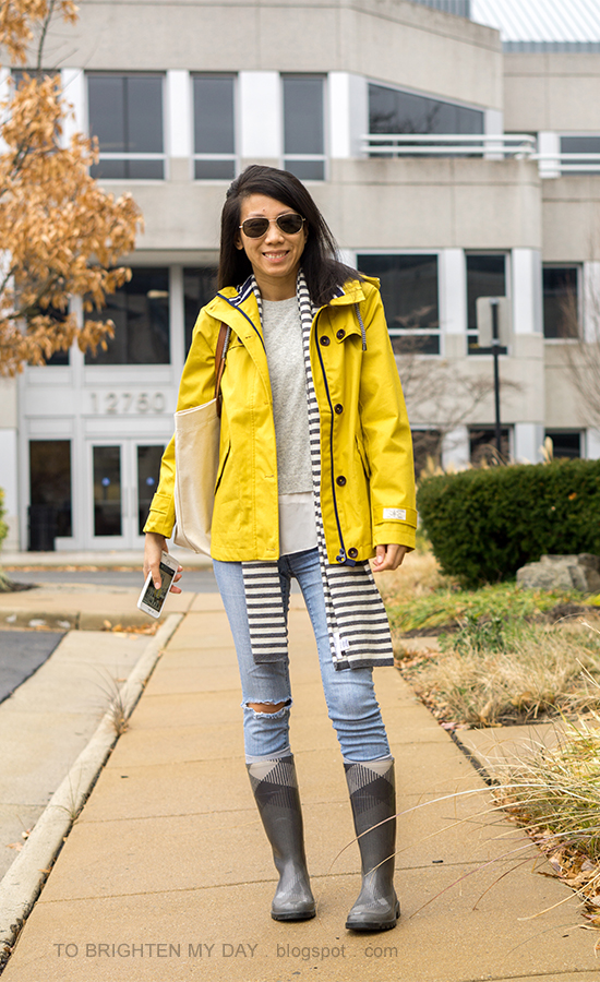 gray open back ruffled sweater, canvas tote, lightwash distressed skinny jeans, socks, checked rain boots, canvas tote, yellow rain coat