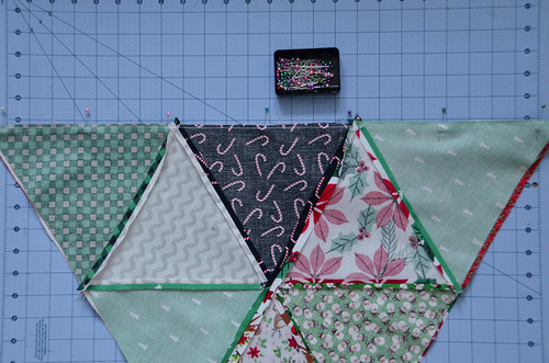 Pin quilt blocks to one another.