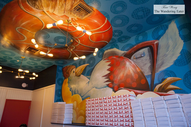 Large chicken and donut mural on the wall and ceiling