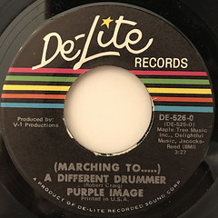 PURPLE IMAGE:(MARCHING TO .....)A DIFERENT DRUMMER(LABEL SIDE-A)