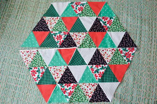 Continue sewing quilt blocks together, leaving one triangle pair unsewn.