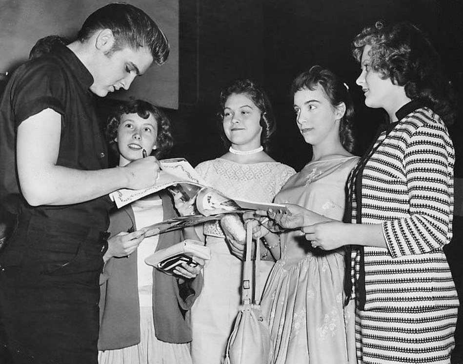 Photo of Elvis Presley signing autographs for some young fans in Minneapolis Minnesota, on June 3, 1956.