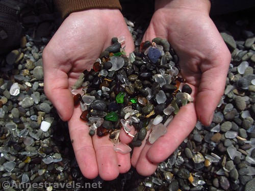 Her wish came true: my disappointed group member holds sea glass and pebbles in her hands at Glass Beach, California