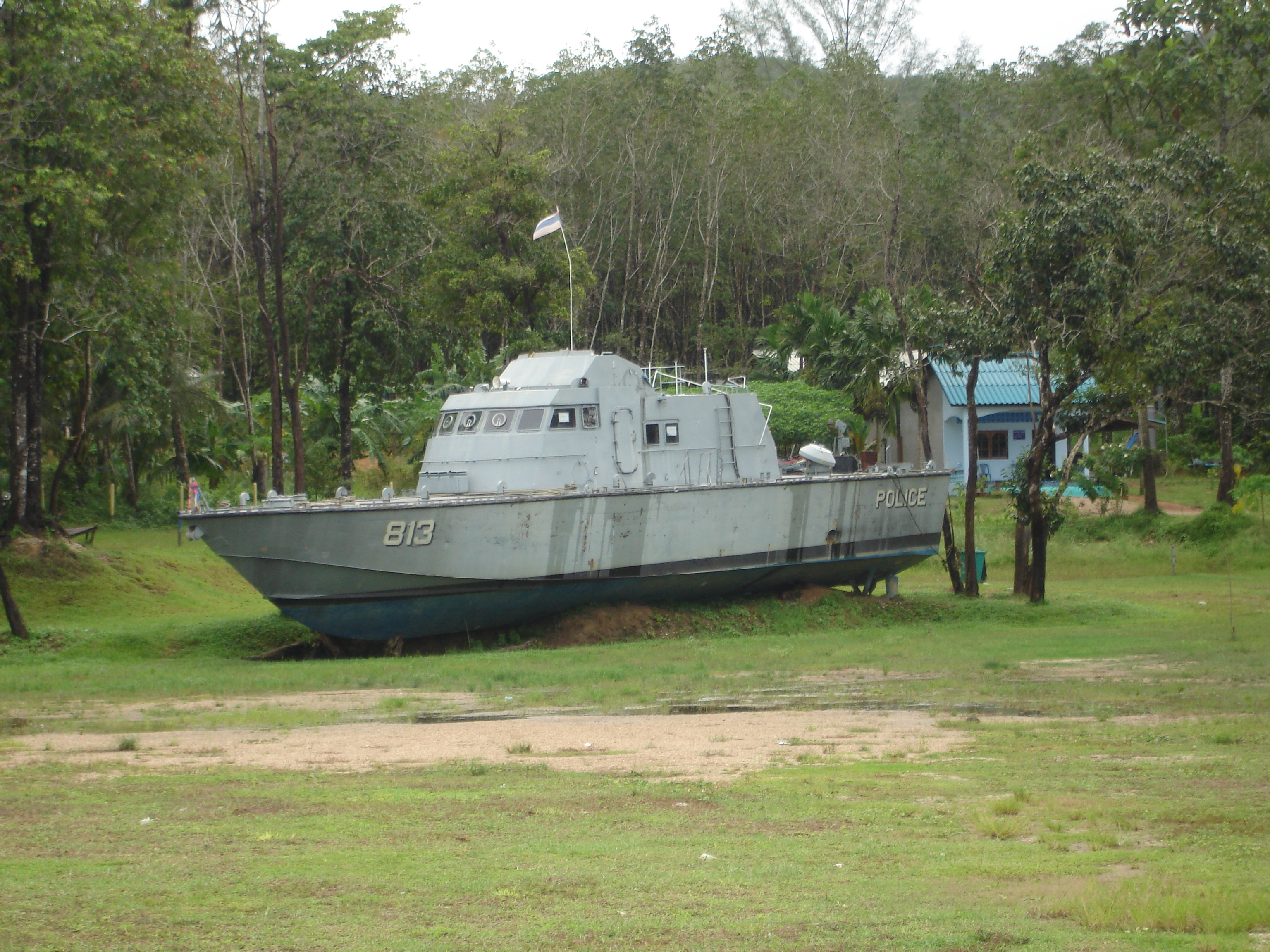 Thai Royal Navy patrol boat 813 was stranded almost 2 km inland at Bang Niang, Khao Lak in Phang Nga Province, Thailand, by the 2004 Boxing Day tsunami. Photo by Mark Jochim on September 30, 2006.