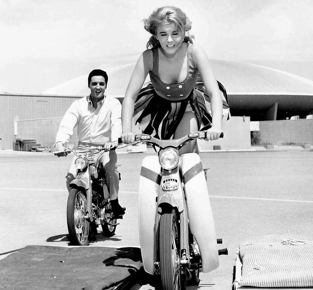 Ann-Margret and Elvis Presley on Honda 50s.