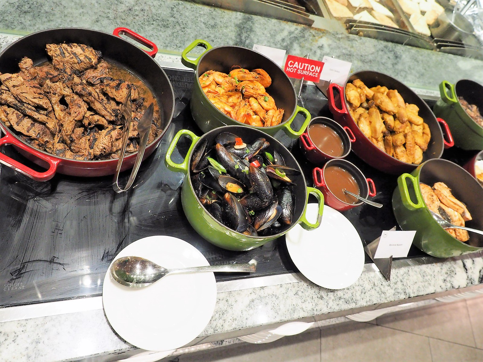 Cooked lamb, mussels, salmon and chicken