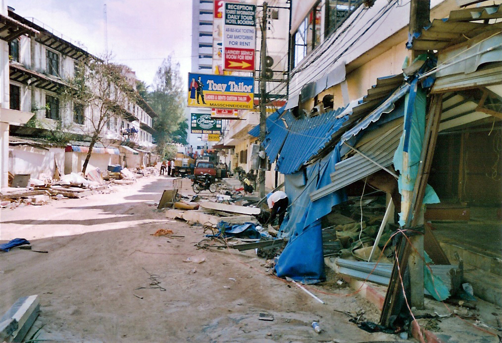 Devastation in the community of Patong on the west coast of Phuket, Thailand, following the 2004 Boxing Day tsunami. The waves traveled up the numerous narrow lanes (called soi) leading eastward, perpendicular to the beach, causing extensive damage to this tourist-oriented town. Photo taken by Vencel Milei in December 2004.