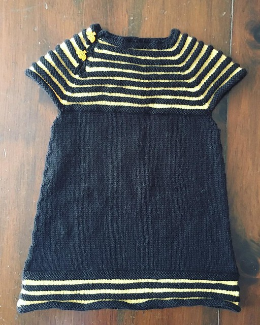 Black and yellow bumblebee dress (with bumblebee buttons). #knitting #littlesisterdress
