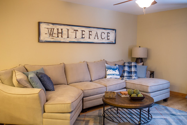Whiteface living area with plush couches and big screen tv; open floor plan makes it perfect for entertaining