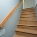 New stair case with custom handrail that has lighting