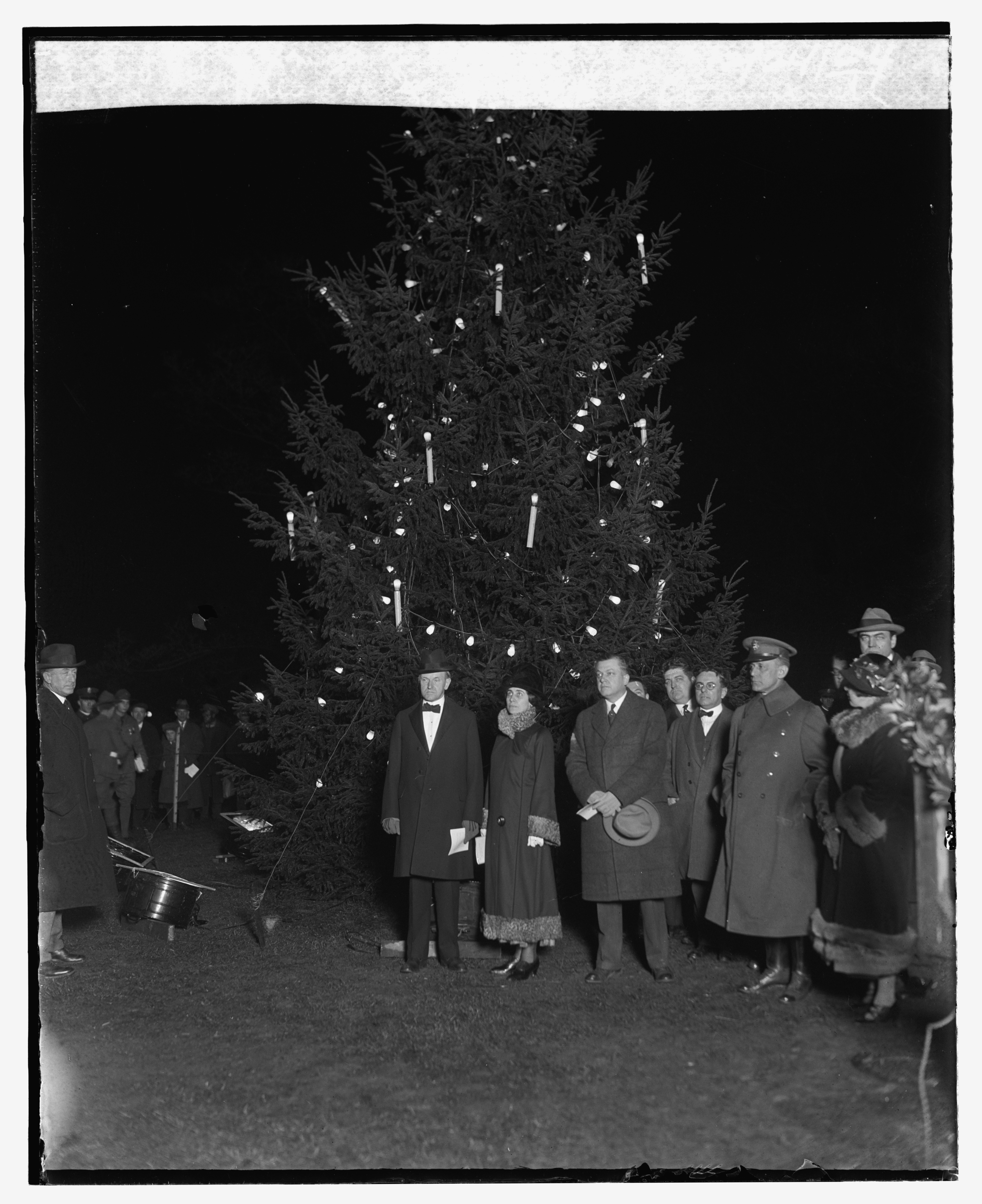 Calvin Coolidge, 30th President of the United States, lights the U.S. National Christmas Tree on Wednesday December 24th, 1924.