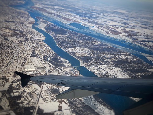 winter snow planewing airplanewing wing iphoneographer iphoneography iphonology iphoneology viewfromabove aerialview michigan windowseat airplane plane river aerial detroitriver