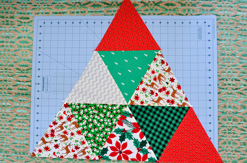 Sew 3 triangle rows together. Bottom row of larger triangle is 5 triangles, middle row is 3 triangles, and top is 1 triangle.