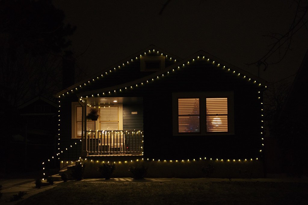 A house is outlined in white Christmas lights in the Irvington neighborhood of Portland, Oregon