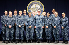 Capt. Scott F. Robertson, commander of Surface Warfare Officers School (SWOS), poses for a group photo with the first 12 ensigns to complete the first pilot Junior Officer of the Deck (JOOD) Course, Dec. 15. (U.S. Navy)