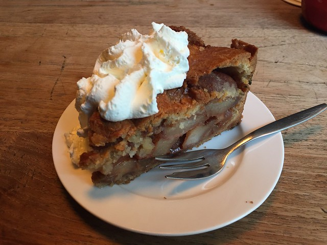 Plate of apple pie with whip cream.