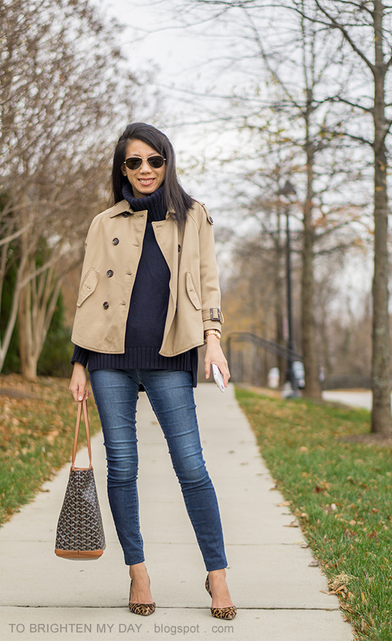 camel trench cape, navy turtleneck tunic sweater, patterned tote, skinny jeans, gold watch, leopard pumps