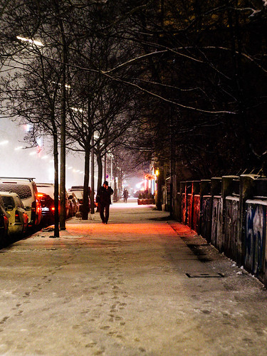 Snowy street at night