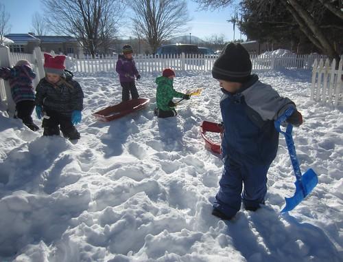 sleds full of snow