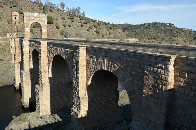 The Alcántara Bridge built over the Tagus River between 104 and 106 AD by a man named Caius Julius Lacer, and dedicated to the Roman emperor Trajan, Spain