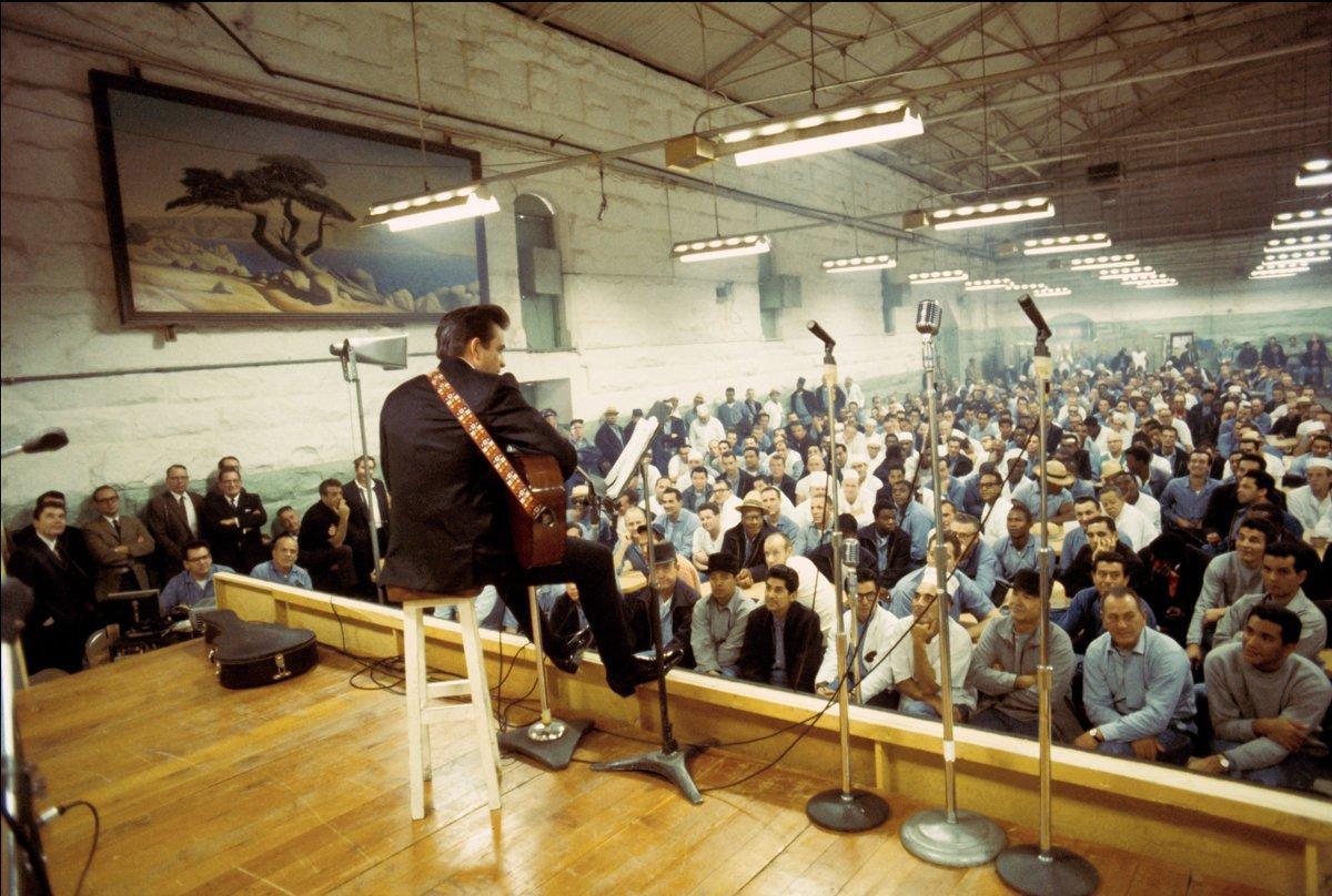 Johnny Cash performs at Folsom Prison.