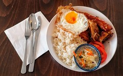 Pork belly braised in soy, vinegar and garlic, garlic fried rice, fried egg, and pickled green papaya.