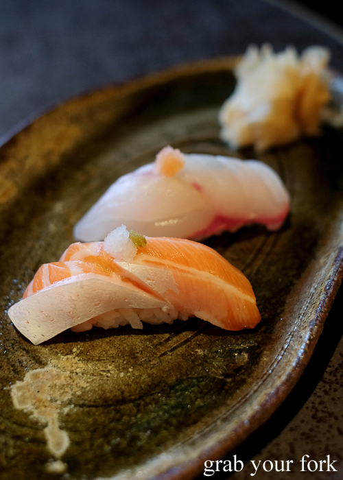 Salmon nigiri sushi and bar cod nigiri sushi, part of our omakase by Chef Ryuichi Yoshii at Fujisaki by Lotus at Barangaroo in Sydney