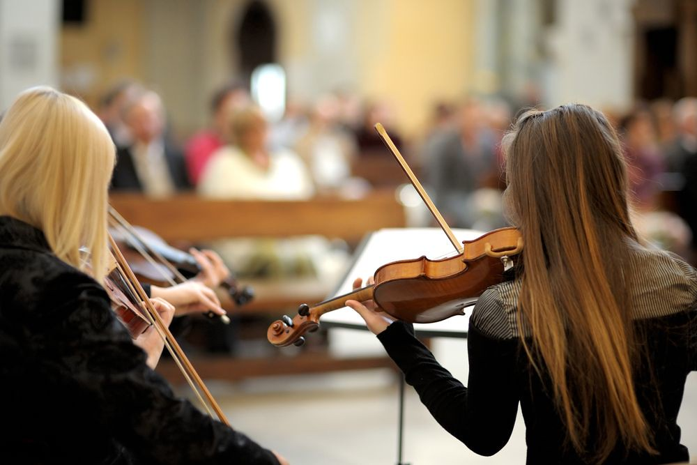 photo of violinists performing
