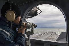 Seaman Carl Jeanlouis communicates with the bridge while standing watch as the ship returns to Naval Base Kitsap – Bremerton, Jan. 29. (U.S. Navy/ MC3 Charles D. Gaddis IV)