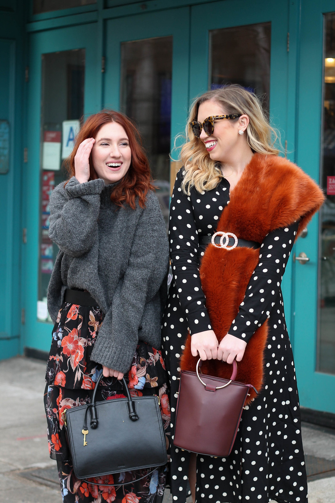 Blogger Besties Girl Wearing Oversized Turtleneck Dark Floral Skirt Blonde Girl wearing Polka Dot Midi Dress Burgundy Ring Bag