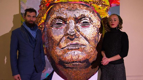 Artists pose with Trump penny portrait