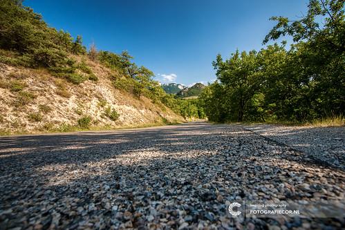 Long winding asphalt road through the mountains.