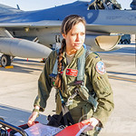 US+Female+F-16+Fighter+Pilot+Capt+Sara+Ferrero+checks+over+the+maintenance+log+prior+to+launching+for+a+Green+Flag+sortie