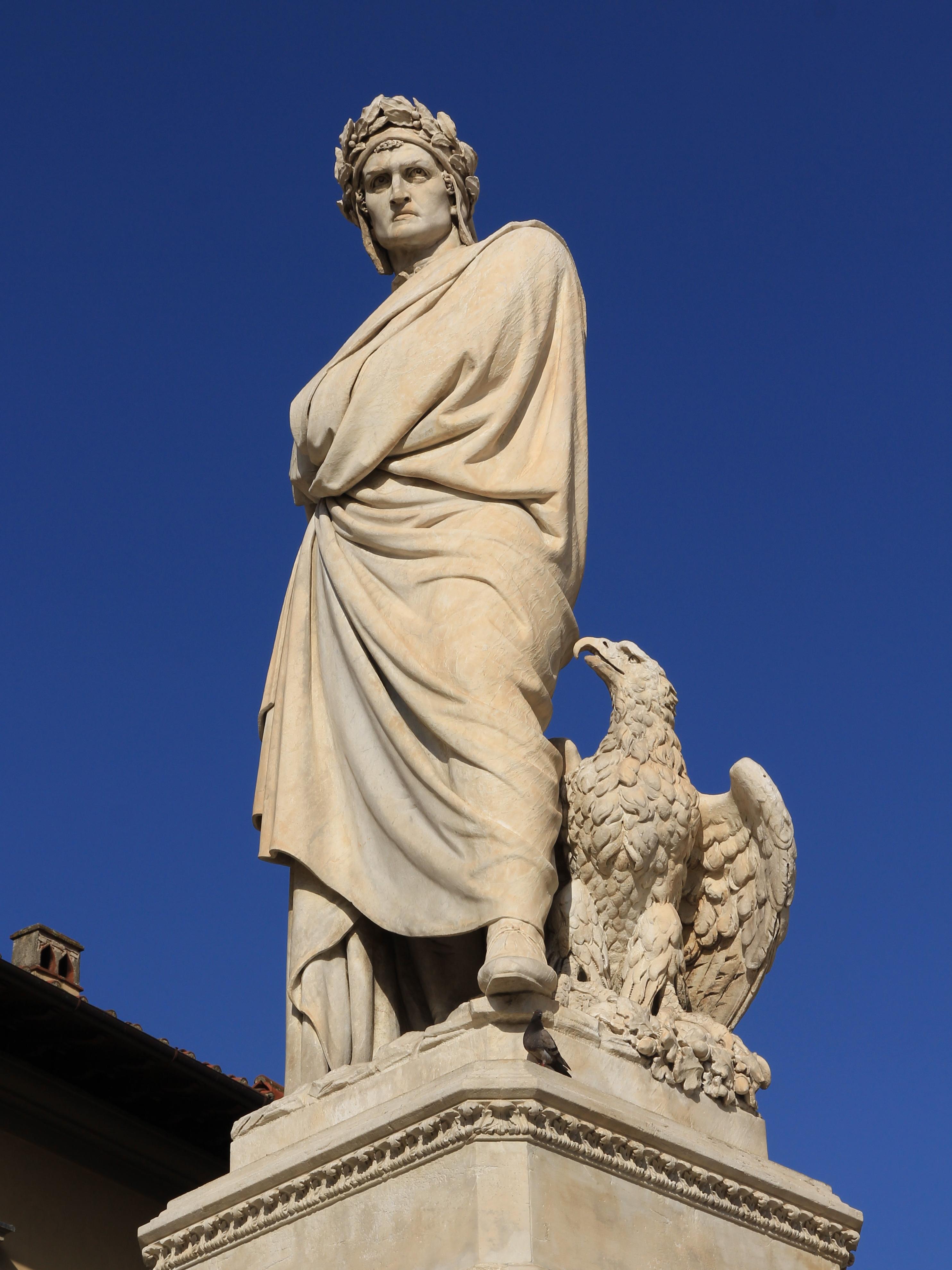 Dante Alighieri statue in the Piazza Santa Croce next to Basilica di Santa Croce (Basilica of the Holy Cross) in Florence, 1865, Enrico Pazzi. Photo taken on August 22, 2011.