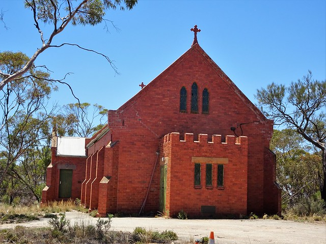 Walpeup. This red brick Catholic Church is now unused and in disrepair. it was completed in 1921 and is the oldest church in the Murrayville to Ouyen districts.