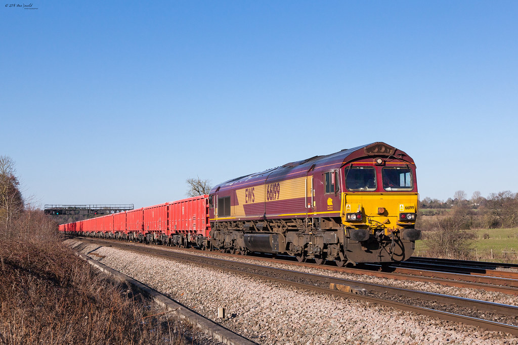 66199 passes Trowell with the 6Z89 1216 Peak Forest Cemex Sdgs to Peterborough West Yard working, on Sunday 25th February 2018.