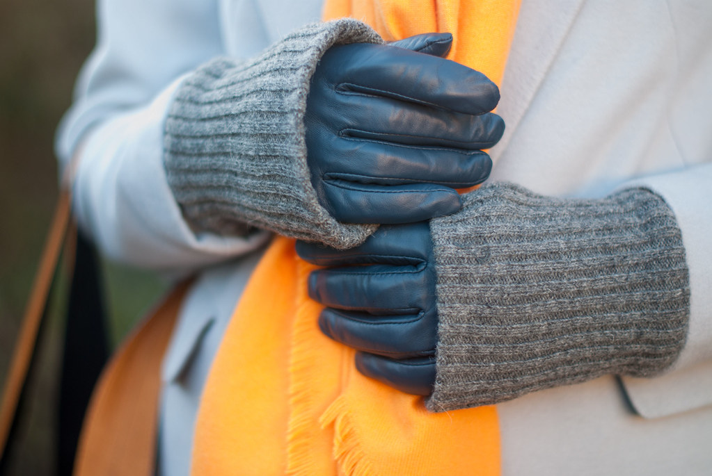 Bold brights winter style: Tangering orange scarf with pale grey duster coat, blue velvet trousers, grey flatforms and taupe pom pom beanie   Not Dressed As Lamb, over 40 style
