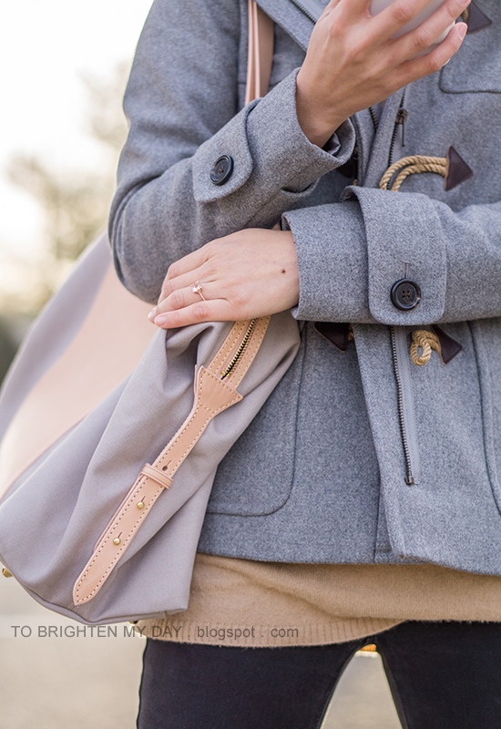 gray wool coat with toggles, camel sweater tunic, black jeans, beige and gray tote, morganite ring