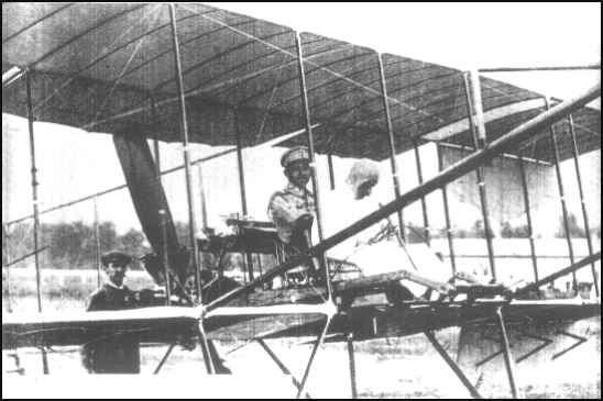 Prince Chakrabongse, Chief of the Army General Staff, sits in the airplane 'Henri Farman IV' with the Belgian pilot Charles Van Den Born at Bangkok, February 6, 1911.. (Photo courtesy Royal Thai Air Force Museum)