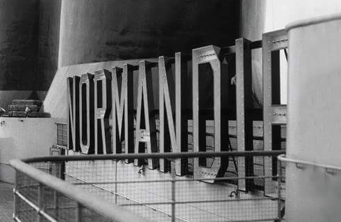 Normandie's large shipboard sign between funnels 2 and 3.