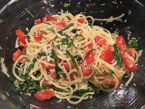 spaghettini added to fresh tomato and basil mixture