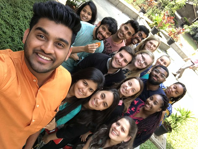 Several MU students posing in a selfie with their interpreters - Pune, India