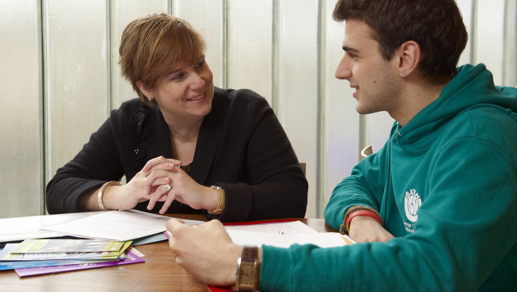 A student having a meeting with their academic supervisor.