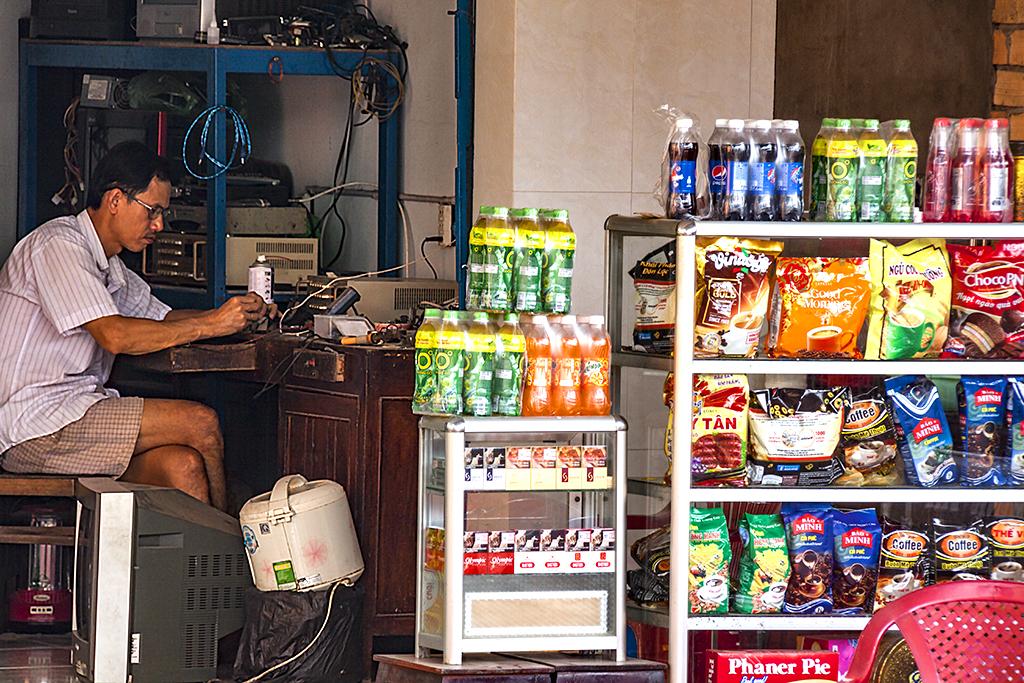Repair man manning store--Vinh Long