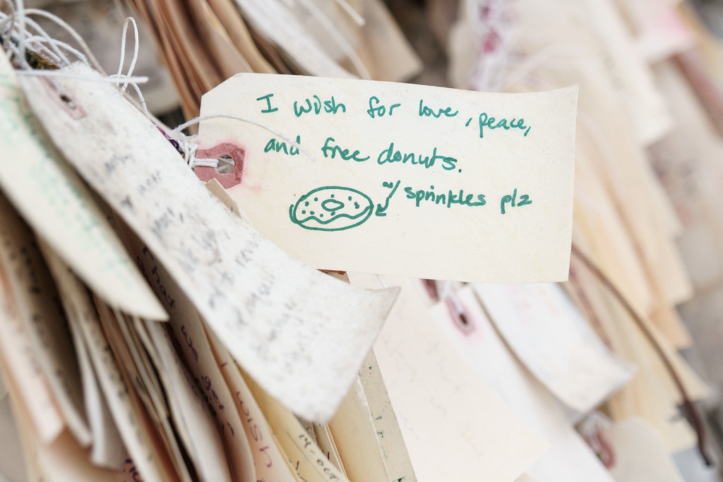 A wish requests love, peace, and free donuts with sprinkles at the Wishing Tree in the Irvington neighborhood of Portland, Oregon